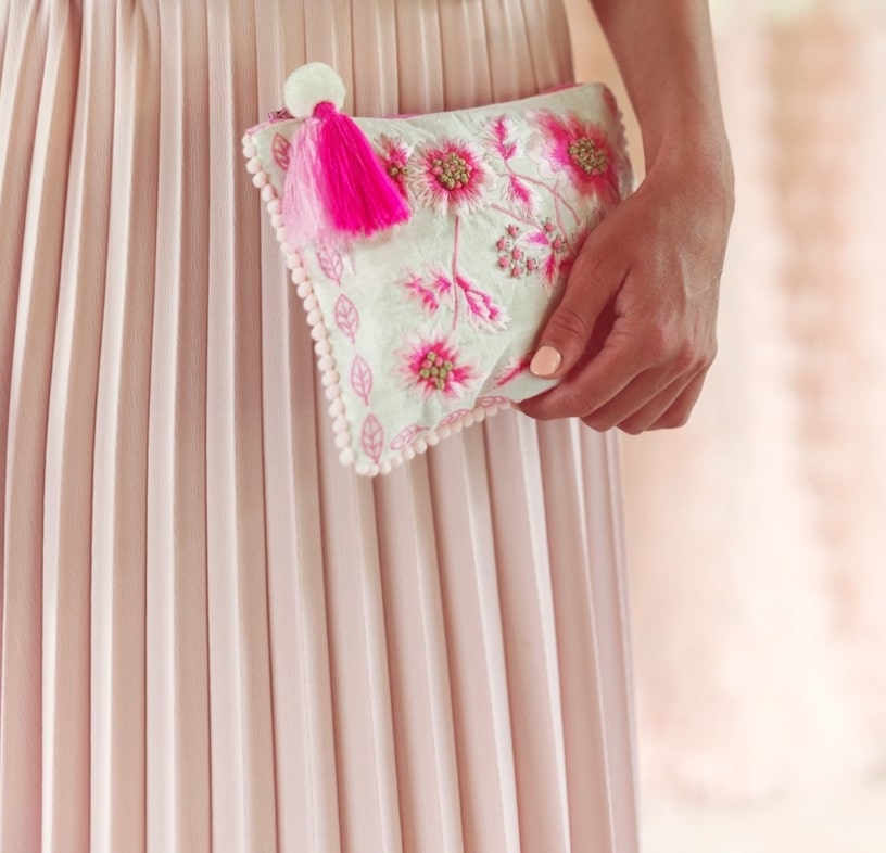 Blanc MariClo' - Pochette collezione Spring, gonna Cruise Collection - Blog